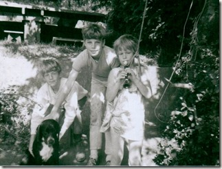 Three kids and Larry