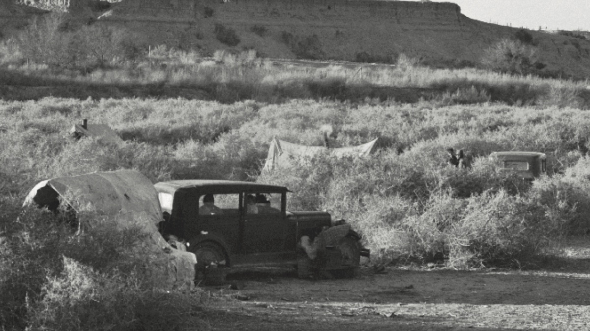 An old-fashioned car in the California desert. Black-and-white photo. Image from Tess Taylor's poetry book Last West.